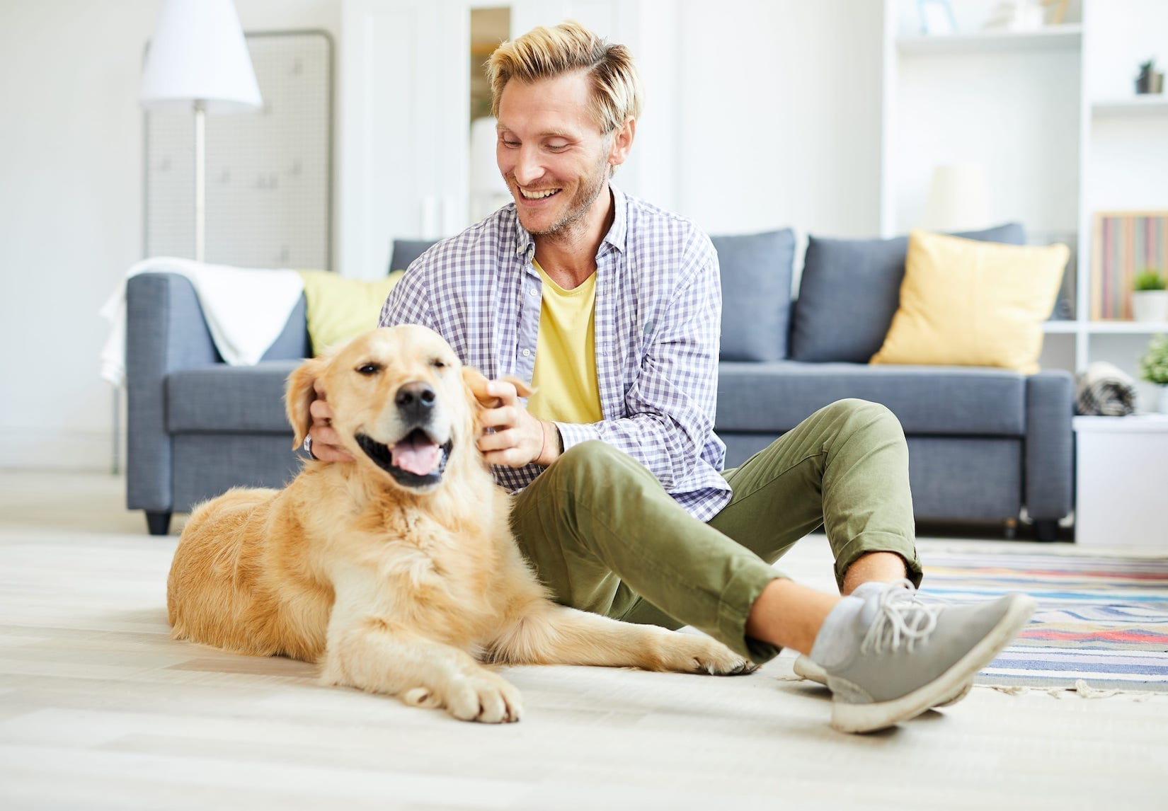 Man Playing with Dog - Kelowna Mortgage Brokers